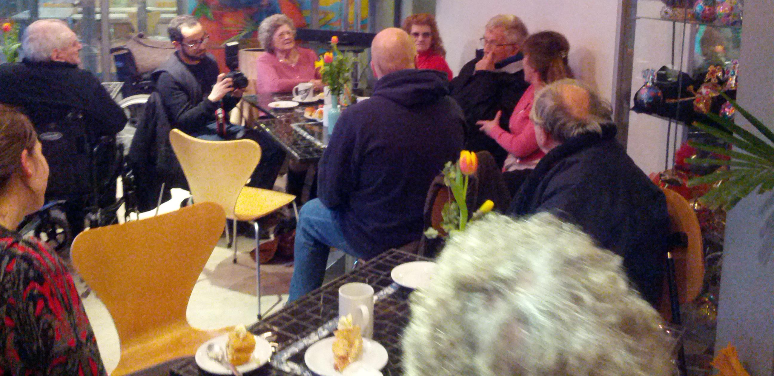 Participants discussing ideas during tea party workshop.